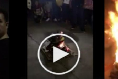 Man burns his nike shoes in public to show support to Manny Pacquiao